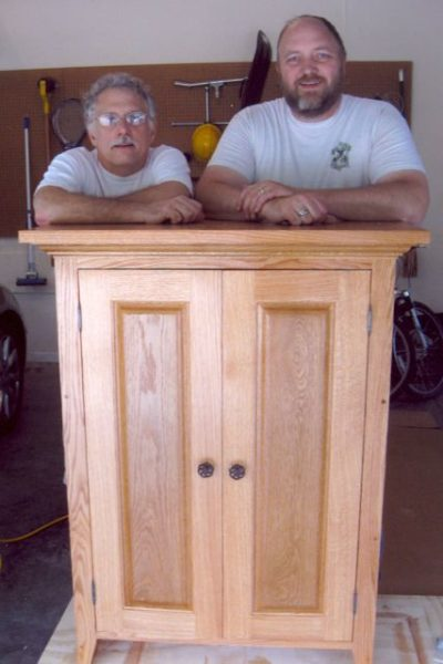 Dr. Rich Jennett and Phil with the jelly cabinet, Phil's first foray into furniture building.